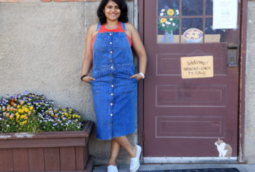 Wearing blue denim overall dress with red top and white sneakers for the 4th of July weekend in Whitefish.
