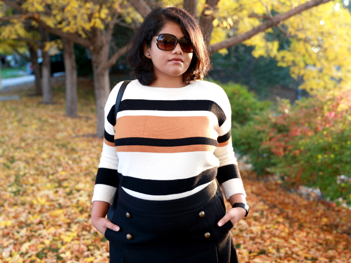 Striped sweater is a fall essential just like a striped tee is for summer. Wear it with a short skirt and tall boots to create a fun or semi-formal look.