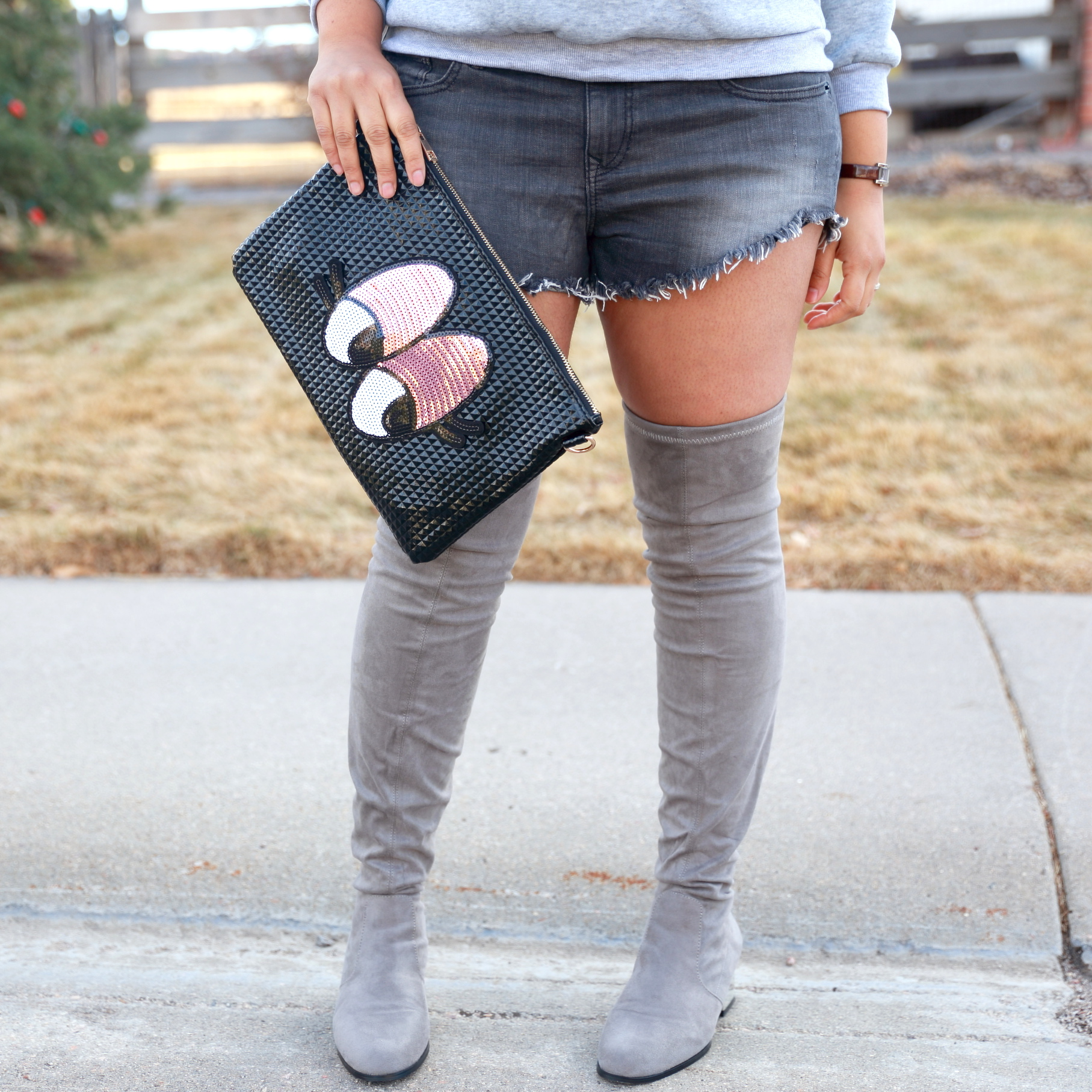 How to wear shorts in cold weather! Select a thicker fabric shorts like tweed, denim or leather and pair it with a cozy sweatshirt or sweater. Wear thigh high or over the knee boots to keep you warm. For extra layering add a scarf or jacket. This makes for a perfect street style.